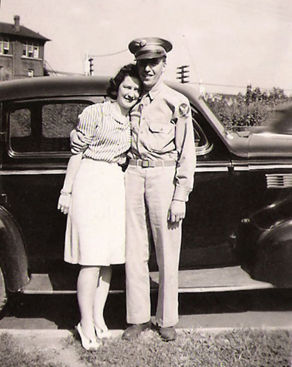 Mom & Dad on Aug 11, 1942. With Dad's 1938 Buick in the background!