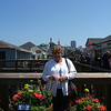 Mom with Beacon hill behind her on Pier