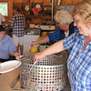 Rose helps to serve the fish boil