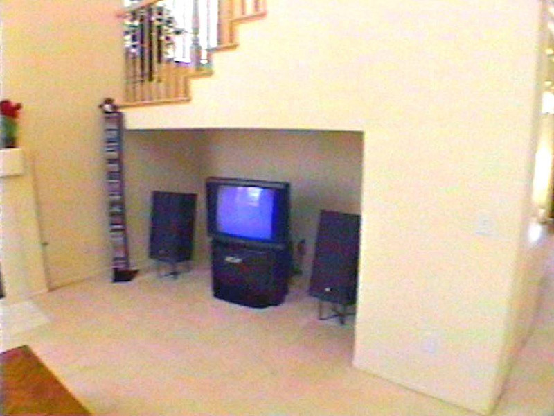 Status<br /> <br /> Tue 20 May 1997. I finally decided the design was complete and placed the order for the 10-ft sheets of MDF. Pre-project picture showing the alcove under the staircase, which is about to be transformed into a built-in entertainment center.