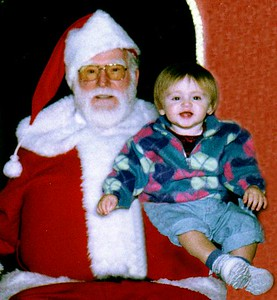 Sydney Jean Kane (and invisible Mom) with a mall Santa. Sydney wouldn't go next to Santa without Mom! Coliseum Mall, Newport News VA.