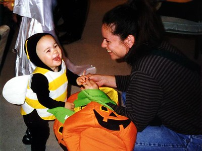 Remi, the bumble bee, with his mom at the Kennedy-Warren Halloween Party.