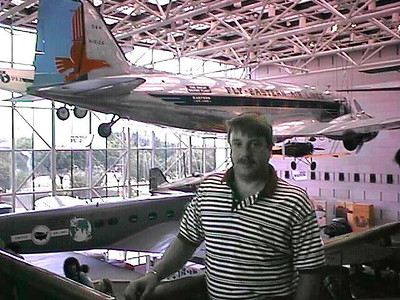 Andrew in front of plane at the Smithsonian Institution's National Air and Space Museum.