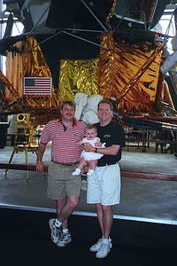 Brothers Pat and Andrew, with Sydney Kane in front of lunar lander module at the National Air and Space Museum.