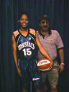 "Andrew next to ""Nikki McCray"" at the WNBA Phoenix Mercury vs. Washington Mystics game at the MCI Center."
