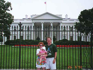 Kathy and Pat with Sydney in front of the White House