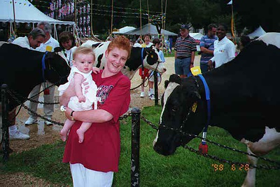 Kathy and Sydney Kane enjoying a festival on the National Mall. Sydney is not quite sure what to do with this cow.