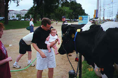 Pat and Sydney Kane enjoying a festival on the National Mall. Pat was trying to get Sydney to pet the cow, but she wouldn't have anything to do with it.