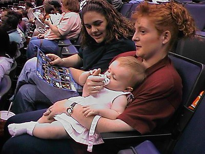 Sydney is getting a little nap time during half-time at the WNBA Phoenix Mercury vs. Washington Mystics game at the MCI Center.