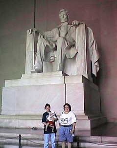Kathy, Sydney and Kathy in front of Abraham Lincoln statue at Lincoln Memorial.