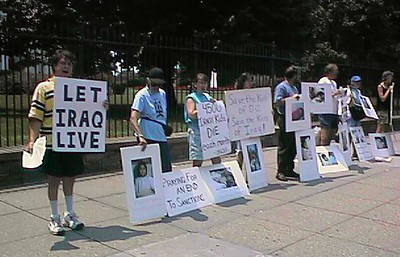 Demonstration in front of the White House. The people are protesting the embargo on Iraq, which is having a detrimental effect on Iraqi children.