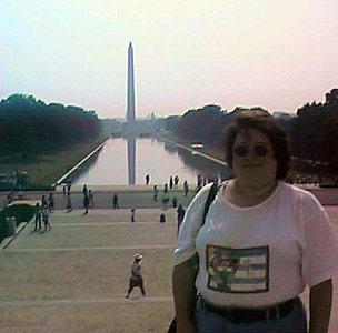 Kathy on Lincoln Memorial steps with Washington Monument and the Reflecting Pool in the background (site of this evening's firework display!).