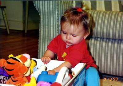 Sydney Jean Kane having a difficult time making a decision with so many toys