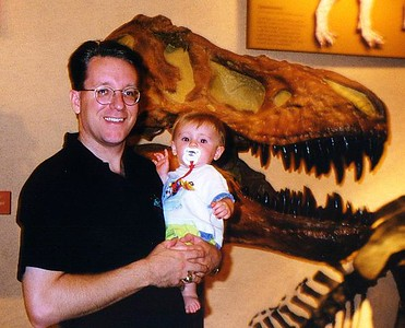 Pat and Sydney Kane in front of a Tyrannosaurus Rex skull at the Natural History Museum