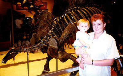 Kathy and Sydney Kane in front of a Stegosaurus at the Natural History Museum