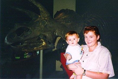 Kathy and Sydney Kane in front of a triceratop at the Natural History Museum