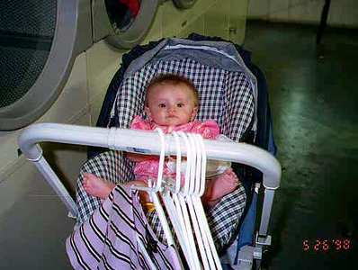 Sydney Jean Kane helping Mom out in the laundry room of the Kennedy-Warren