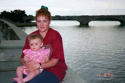 Kathy and Sydney along the Potomac River with the Arlington Memorial Bridge in the background.