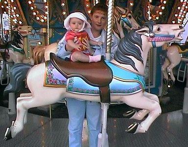 Sydney's first carousel ride! Kathy said she didn't want to get off the horse afterwards :-)