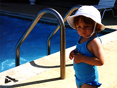 Sydney is circling around the pool to figure out whether she wants to go in or not (not!).
