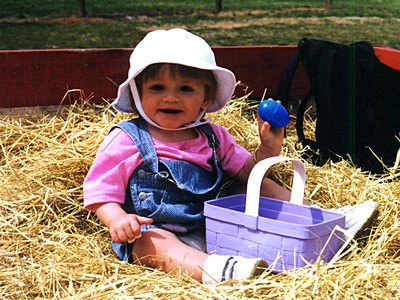 Time for a hay ride. Sydney Jean Kane showing Kathy the eggs she found today at Butler's Orchard.