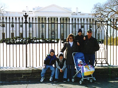 Betsy and Frank Roth, with their boys (from left to right--Nathan, Ryan and Grady) and Sydney Kane in front of the White House.
