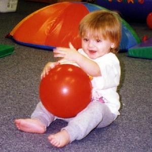 Sydney Jean Kane having a ball at Gymboree.