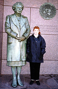 Kathy Kane next to Eleanor Roosevelt, who is depicted in a sculpture by Neil Estern with the United Nations symbol in the background--the first time a First Lady has been so memorized. Room Four of the Franklin Delano Roosevelt Memorial, Washington DC.