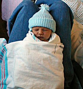 Christopher Ross Kane (born 25 Jan 2000) taking one of many naps on his Dad's (Patrick Kane) lap. Ventura CA. 26 Jan 2000.