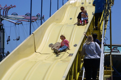 Sydney leading Mom and Christopher down the Super Slide at the Seabee Days festival