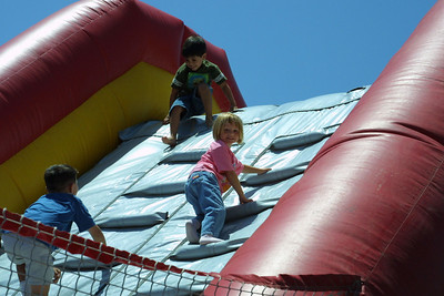 Sydney having fun on the large Jolly Jump and slide at the Seabee Days festival