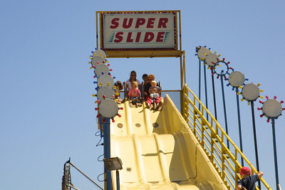 Kathy, Sydney and Christopher about to go down the Super Slide at the Seabee Days festival