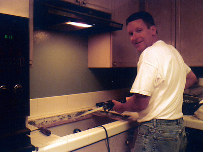 Always willing to put his tools to use, Pat is squaring up the corners in the countertop for the new Thermador SGCS304 30-in gas cooktop since it was slightly larger than the previous cooktop.