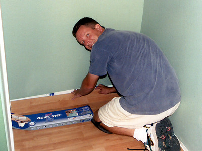 Pat is snapping together the new wood laminate floor, which is Quick-Step's Uniclic Planks (U-781 Select Birch).