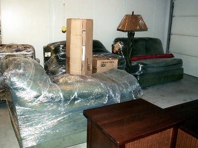 The new family room furniture from La-Z-Boy was stored in the garage until the laminate wood floor was installed.