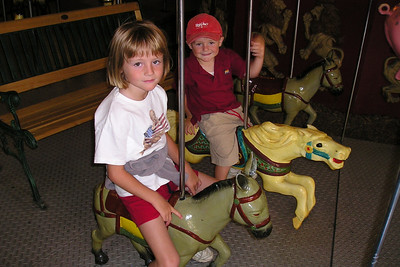 Christopher didn't want to ride alone, so Sydney tagged along on the carousel in Ventura Harbor.
