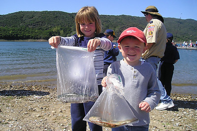 Sydney and Christopher Kane with trout caught in the stocked pool during the kids' fishing day at Lake Casitas. The Casitas Municipal Water District also brought in trout from a hatchery in Utah and released them into the lake while the kids watched.