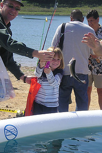 Sydney Kane is looking pretty happy with the trout she caught during the kids' fishing day at Lake Casitas.