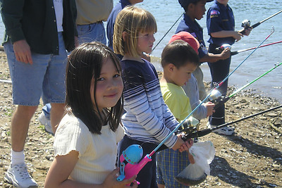 Sierra Moore, Sydney Kane, Eli Moore and Christopher Kane (hiding behind Eli) ready to try their luck in Lake Casitas during the kids' fishing day that was organized by the Casitas Municipal Water District.
