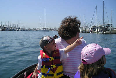 Christopher Kane is showing Aunt KK the flags flying at the Pacific Corinthian Yacht Club in the Channel Islands Harbor.