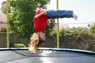 Sydney doing a flip on her new trampoline.