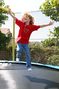 Sydney having a blast on the new trampoline that Aunt Betsy bought for Sydney and Christopher as a belated Christmas/birthday gift. Pat was able to buy it and get it assembled (with the help of Ernie) just before Kathy and the kids returned from Australia.