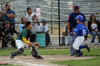 Simon Roth coming home during a King City All-Stars baseball game. He's safe!