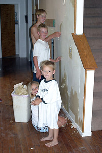 As usually happens, one project leads to the next. Betsy decided that the wallpaper needed to be removed, so she recruited her niece (Sydney) and nephews (Liam and Simon) as well as her son (Grady). Since this walls backs up to the staircase, there is just enough room underneath the stairs for the built-in microwave cabinet.