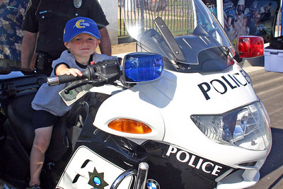 Christopher loves motorcycles and got a chance to sit on a police motorcycle during Seabee Days.