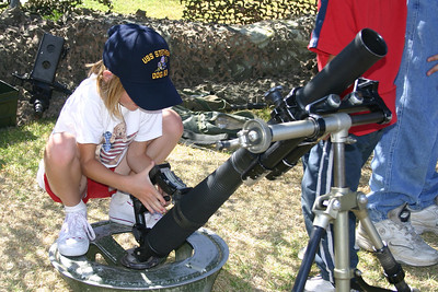 Sydney having a hard time squeezing off a mortar round during Seabee Days.