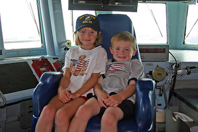 Christopher and Sydney in the captain's chair aboard the USS Stethem DDG-63 during Seabee Days.