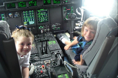 Sydney Kane and her classmate, Julia, aboard a new C-130 during a class field trip to the California Air National Guard station.