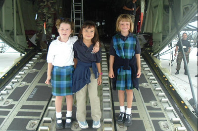 Sydney Kane with her friends, Julia and Sierra, aboard a new C-130 during a class field trip to the California Air National Guard station.