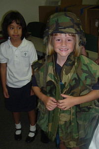 Sydney trying on the flak jacket and helmet during her class' field trip to the California Air National Guard station at Point Mugu.